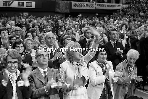 Ecstatic delegates at the Conservative Party Conference Brighton Sussex 1980. Banner reads Magge's Magic REF MARGARET THATCHER.
