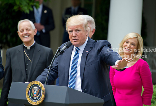 United States President Donald J. Trump makes remarks prior to signing a Proclamation designating May 4, 2017 as a National Day of Prayer and an Executive Order &quot;Promoting Free Speech and Religious Liberty&quot; in the Rose Garden of the White House in Washington, DC on Thursday, May 4, 2017. <br /> Credit: Ron Sachs / CNP