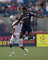 New England Revolution forward Kenny Mansally (7) attempts to control the ball as Philadelphia Union defender Carlos Valdes (5) defends. In a Major League Soccer (MLS) match, the Philadelphia Union defeated the New England Revolution, 3-0, at Gillette Stadium on July 17, 2011.