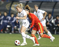 Amy Rodriguez #8 of the USA WNT races away from Na Zhang #6 of the PRC WNT during an international friendly match at PPL Park, on October 6 2010 in Chester, PA. The game ended in a 1-1 tie.