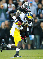 WEST LAFAYETTE, IN - OCTOBER 06: Wide receiver Devin Gardner #12 of the Michigan Wolverines makes a reception that resulted in a touchdown as cornerback Josh Johnson #28 of the Purdue Boilermakers tackles from behind at Ross-Ade Stadium on October 6, 2012 in West Lafayette, Indiana. (Photo by Michael Hickey/Getty Images) *** Local Caption *** Devin Gardner; Josh Johnson