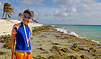 14 August 2007: Joshua smiles for the camera at Pink Beach on the island of Bonaire, in the Netherland Antilles. ..Mandatory Photo Credit: Ed Wolfstein Photo