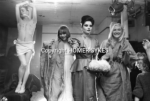 "Blitz Kids New Romantics at The Blitz Club Covent Garden, London, England 1980. Princess Julia (centre ) handing out Easter Eggs they had just performed the song, Death Where is Thy Sting?  [L-R] Iain R Webb [fashion author, editor journalist],  Jennifer Binnie,  and sister Christine ""Miss Binnie"""