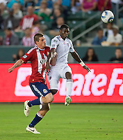 CARSON, CA – July 2, 2011: Chivas USA forward Justin Braun (17) and Chicago Fire defender Jalil Anibaba (6) during the match between Chivas USA and Chicago Fire at the Home Depot Center in Carson, California. Final score Chivas USA 1, Chicago Fire 1.
