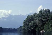 Tourist launch in the Cuero y Salado Wildlife Refuge near la Ceiba, Honduras. Pico Bonito in background.