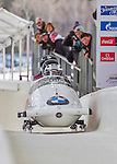 9 January 2016: Canadian pilot Justin Kripps leads his 4-man team as they cross the finish line after their second run of the day at the BMW IBSF World Cup Bobsled Championships at the Olympic Sports Track in Lake Placid, New York, USA. Kripps' team came in 3rd for the day, with a 2-run combined time of 1:50.07. Mandatory Credit: Ed Wolfstein Photo *** RAW (NEF) Image File Available ***