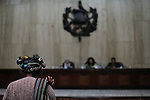 Witness Magdalena Marcos De Leon, Ixil Mayan woman from Nebaj, raises her right hand before beginning her sworn testimony during the sixth day of the historic genocide trial against former de facto dictator Efrain Rios Montt and his head of Intelligence Jose Mauricio Rodriguez Sanchez. Both are accused of genocide and crimes against humanity committed against the Ixil Mayan people during their de facto reign from March 1982 to August 1983. Ms. Marcos De Leon states: &quot;After the army attacked our village, I saw how they captured my husband and decapitated him. I ran to the mountain with my five children and we remained there for a long time.&quot; Guatemala, Guatemala. March 26, 2013.