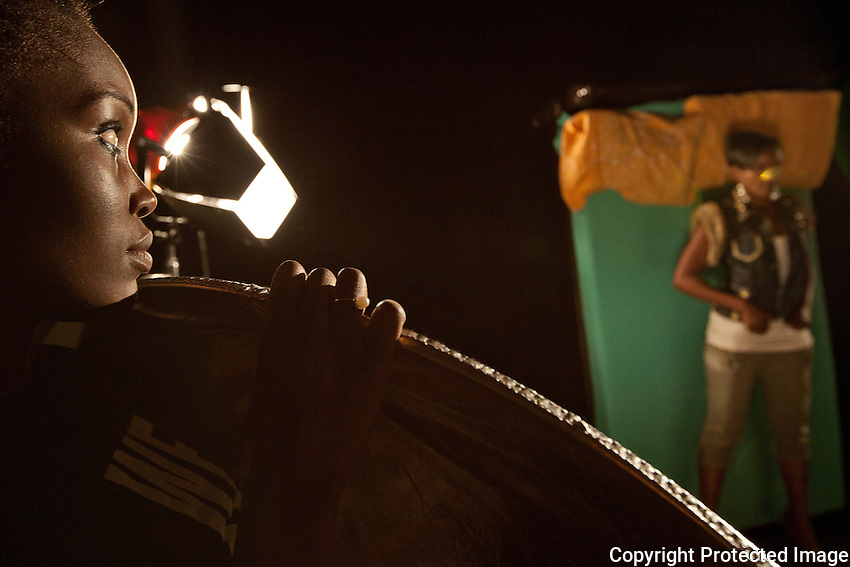 Associate video producer Diana Mekeye bounces light on Kenyan recording artist VQEE during  a shoot for the miusic video for &quot;Pole Musa&quot; a remake of one of Kenya's pop classics. The song was originally made famous by Daudi Kabaka, a leading post-independence musician active in the 1960's.                      The song is about an abused woman and VQEE hopes that it spreads a message against violence as well as getting a new generation of Kenyans in touch with their musical legacy.