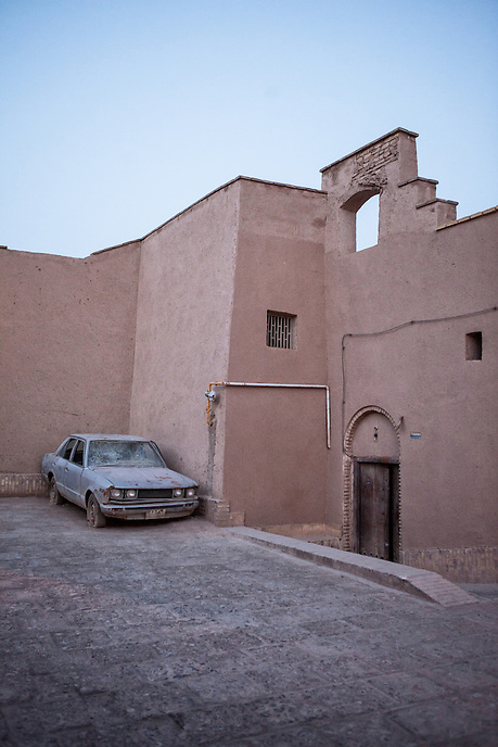 A broken car at the old city of Yazd. Located in the middle of the desert in Central Iran, Yazd is arguably one of the oldest living city in the world. Yazd was visited by Marco Polo in 1272, who described it as a good and noble city and remarked its silk production. The name Yazd means worship.