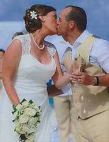Allison and Jared kiss during the wedding ceremony