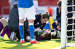 Hamilton Academical St Johnstone....04.04.15<br /> Michael McGovern is treated after a head knock<br /> Picture by Graeme Hart.<br /> Copyright Perthshire Picture Agency<br /> Tel: 01738 623350  Mobile: 07990 594431