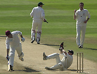 Photo Peter Spurrier.01/09/2002.Village Cricket Final - Lords.Elvaston C.C. vs Shipton-Under-Wychwood C.C..Shipton's Steve Bates beats the run out as Elvaston's wicket-keepe,r Lee Archer, catches the badley directed throw from the field.