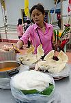 Woman prepares an offering table at a temple in rural Thaliand