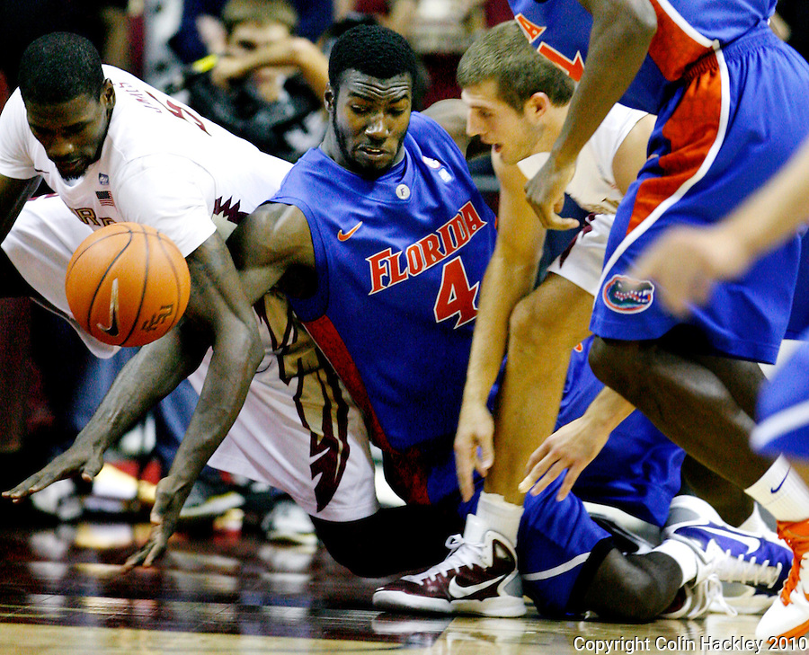 TALLAHASSEE, FL 09-FSU-UF MBB10 CH-Florida State's Bernard James, left, and Luke Loucks battle with Florida's Patric Young for the ball during first half action Sunday at the Donald L. Tucker Center in Tallahassee...COLIN HACKLEY PHOTO