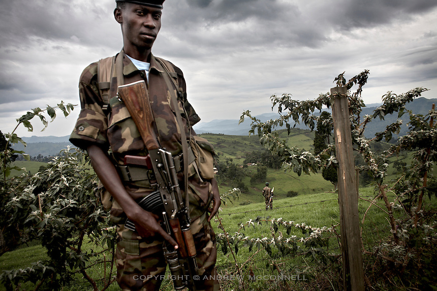 CNDP (National Congress for the Defence of the People) soldiers patrol the hills around General Nkunda's base in Kilolirwe, North Kivu, DRC.