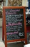 Blackboard menu outside Parisian restaurant.