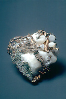 SILVER Filigree in quartz matrix<br /> Silver (Ag) sometimes found in cubic or octahedral crystals, more often in long distorted wires in matrix.