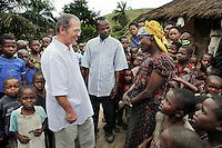 Surrounded by curious children, Doctor Richard Hardi and one of his medical assistants talks to a woman in the remote village of Pania where he has come to perform eye surgery. <br /> <br /> From his base in Mbuji Mayi Hungarian ophthalmologist Friar Richard Hardi and his team travelled deep into the Congolese rainforest, by 4x4 and canoe, to treat people in isolated communities most of whom have never seen an ophthalmologist. At a small village called Pania they established a temporary field hospital and over the next three days made hundreds of consultations. Although both conditions are preventable, many of the patients they saw had Glaucoma or River Blindness (onchocerciasis) that had permanently damaged their eyesight. However, patients with cataracts, a clouding of the eye's lens, who were suitable for treatment were booked for an operation. For two days the team carried out the ten minute procedure on one patient after another. The surgery involves making a 2.2mm incision into the remove the damaged lens that is then replaced by an artificial one. Doctor Hardi is one of the few people willing to make such a journey but is inspired to do so by his faith and, as he says: 'Here I feel that I can really make a difference in people's lives'. /Felix Features