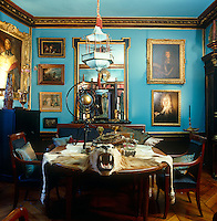 "The electric ""Cotton Blue"" of the walls and gilt-framed paintings have created a jewel-box feel to the library of this Empire-style Parisian apartment"