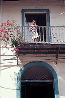 Child on the balcony of an old house in Casco Viejo, Panama City, Panama