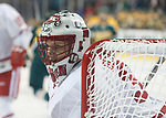 ST CHARLES, MO - MARCH 19:  Ann-Ren&eacute;e Desbiens (30) of the Wisconsin Badgers keeps an eye on the puck <br /> during the Division I Women's Ice Hockey Championship held at The Family Arena on March 19, 2017 in St Charles, Missouri. Clarkson defeated Wisconsin 3-0 to win the national championship. (Photo by Mark Buckner/NCAA Photos via Getty Images)
