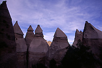 New Mexico's Kasha-Katuwe Tent Rocks National Monument, where erosion chisels rock formations formed by explosive volcanic eruptions between six and seven million years ago. While the formations are uniform in shape, they vary in height from a few feet to 90 feet throughout the 4,000 acre monument.