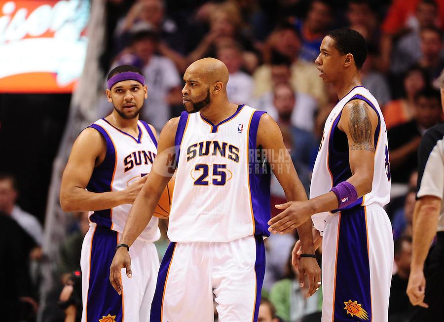Mar. 30, 2011; Phoenix, AZ, USA; Phoenix Suns guard (25) Vince Carter with forward Jared Dudley (left) and center Channing Frye against the Oklahoma City Thunder at the US Airways Center. Mandatory Credit: Mark J. Rebilas-.