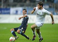 Fussball 2. Bundesliga:  Saison   2012/2013,    10. Spieltag  TSV 1860 Muenchen - FC Erzgebirge Aue  22.10.2012 Maximilian Nicu  (li, 1860 Muenchen) gegen Kevin Schlitte (FC Erzgebirge Aue)