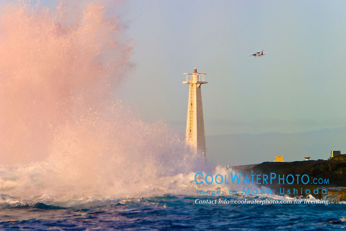 big ocean waves, pounding on lava rocks and lighthouse at Keahole Point, Kona Coast, Big Island, Hawaii, USA, Pacific Ocean