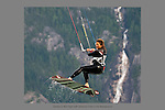 July 22nd, 2009. Kiteboarder Sandra Bicego catches some big air with the local landmark Shannon falls in the background.  Squamish, BC.  Photo by Gus Curtis.