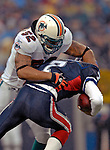 17 December 2006: Miami Dolphins linebacker Channing Crowder (52) sacks Buffalo Bills quarterback J.P. Losman (7) at Ralph Wilson Stadium in Orchard Park, New York. The Bills defeated the Dolphins 21-0.. .Mandatory Photo Credit: Ed Wolfstein Photo<br />