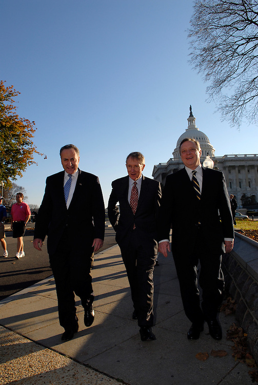 "Charles Schumer, D-N.Y., Senate Minority Leader Harry Reid, D-Nev., and Senate Minority Whip Richard Durbin, D-Ill., heads to a news conference to mark the ""dawning"" of a new Democratic majority in the United States Senate. The event in the Upper Senate Park was cut short by U.S. Capitol Police when staff photographer John Shinkle of the Capitol Leader left his bag unattended causing them to call in the SWAT team and bomb squad."