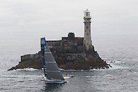 IRELAND, Fastnet Rock. 2nd July 2012. Volvo Ocean Race, Leg 9, Lorient to Galway. Team Telefonica rounds the Fastnet Rock.