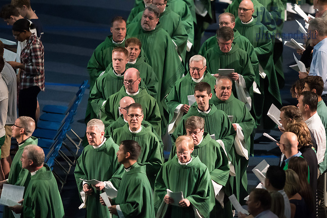 August 21, 2016; Congregation of Holy Cross priests process into the Purcell Pavilion for the 2016 Welcome Weekend Mass. (Photo by Matt Cashore/University of Notre Dame)