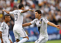 CARSON, CA - DECEMBER 01, 2012:   Juninho (19) and  Omar Gonzalez (4) of the Los Angeles Galaxy after Gonzalez had scored against the Houston Dynamo during the 2012 MLS Cup at the Home Depot Center, in Carson, California on December 01, 2012. The Galaxy won 3-1.