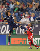 New England Revolution defender Kevin Alston (30) heads the ball as Toronto FC forward Joao Plata (7) closes. In a Major League Soccer (MLS) match, the New England Revolution tied Toronto FC, 0-0, at Gillette Stadium on June 15, 2011.