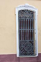 Cuba, Cienfuegos.  Wrought-iron Window Grille.