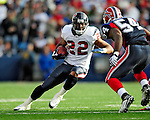 1 November 2009: Houston Texans' running back Chris Brown rushes for a seven yard gain and a first down in the third quarter against the Buffalo Bills at Ralph Wilson Stadium in Orchard Park, New York, United States of America. The Texans defeated the Bills 31-10. Mandatory Credit: Ed Wolfstein Photo