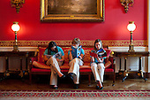 Students, from left, Gaby Dempsey, 12, Kate Murray, 13, and Mackenzie Grewell, 13, read in the Red Room of the White House after setting up their science fair exhibit, February 6, 2012. The three girls, part of the Flying Monkeys First Lego League Team from Ames Middle School in Ames, Iowa, participated in the second annual White House Science Fair with over 100 students from 45 states. .Mandatory Credit: Sonya N. Hebert - White House via CNP