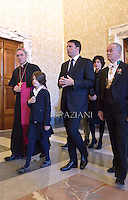 Monsignor Georg Gänswein,Pope Francis  meets Italian Premier Matteo Renzi and his family during a private audience at the Vatican, on December 13, 2014.