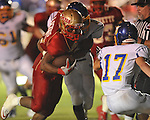 Lafayette High's Demarkous Dennis (5) is hit by Oxford High's Robert Liggins (1) and scores a touchdown at William L. Buford Stadium in Oxford, Miss. on Friday, September 2, 2011. Lafayette won 40-12