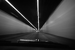 Car going through tunnel at high speed with motion