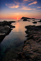 A soothing sunset over the calm waters of the Tyrrhenian sea at Marina di Mutu, the tiny harbor of the town of Centuri in the Cap Corse, Corsica, France