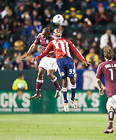 Chivas USA forward Victor Estupinan (99) and Colorado Rapids defender Marvell Wynne (22) go high to battle for the ball during the first half of the game between Chivas USA and Colorado Rapids at the Home Depot Center in Carson, CA, on March 26, 2011. Final score Chivas USA 0, Colorado Rapids 1.