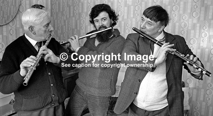 N Ireland-born virtuoso flautist James Galway enjoys a session with two old friends from flute band days in Belfast during a visit to his home city on 30th January 1976. 197601300073a..Copyright Image from Victor Patterson, 54 Dorchester Park, Belfast, United Kingdom, UK...For my Terms and Conditions of Use go to http://www.victorpatterson.com/Victor_Patterson/Terms_%26_Conditions.html