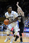 30 November 2014: Duke's Justise Winslow (12) and Army's Tanner Plomb (32). The Duke University Blue Devils hosted the West Point Military Academy Army Black Knights at Cameron Indoor Stadium in Durham, North Carolina in a 2014-16 NCAA Men's Basketball Division I game. Duke won the game 93-73.