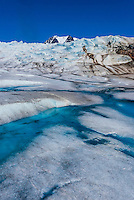 Aerial view taken hovering 10 feet above the Mendenhall Glacier, showing azure colored ice pools (that you can walk on); Juneau, Alaska USA.