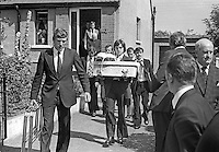A family member carries the tiny coffin of one of the three children, Joanne, 8 years, John, 2 years, and Andrew, 6 weeks, who died as a result of one of the most tragic and horrific incidents of the N Ireland Troubles on 10th August 1976. A car driven by Daniel Lennon, aka Danny Lennon, member, Provisional IRA,  mounted the pavement and ploughed into the Maguire family. Lennon died at the wheel having been shot by British soldiers in hot pursuit. The incident gave rise to the birth of the Peace People organisation led by Mairead Corrigan, aunt of the dead children, and a local woman,Betty Williams. 197608130371g..Copyright Image from Victor Patterson, 54 Dorchester Park, Belfast, United Kingdom, UK.  Tel: +44 28 90661296; Mobile: +44 7802 353836; Voicemail: +44 20 88167153;  Email1: victorpatterson@me.com; Email2: victor@victorpatterson.com..For my Terms and Conditions of Use go to http://www.victorpatterson.com/Terms_%26_Conditions.html