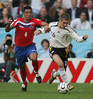 JUNE 9, 2006: Munich, Germany: German defender Philipp Lahm (16) tries to get past Costa Rican defender Michael Umana (4) during the World Cup Finals in Munich, Germany.  Germany defeated Costa Rica, 4-2.