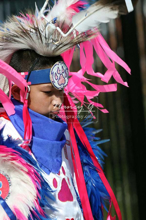 A teenager Native American Indian boy dancing at a Pow Wow at the Milwaukee Lakefront Indian Summer Festival, Wisconsin
